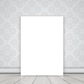 Пустой холст на полу, прислонившись к стене с дамасской рисунком обоев