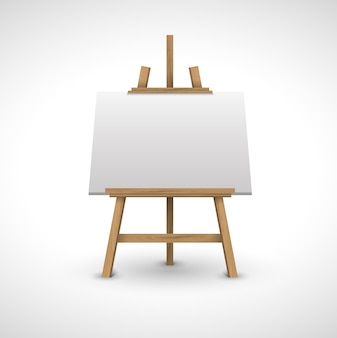Blank canvas on a wooden easel on a white background