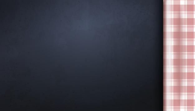 赤いピクニックテーブルクロスとcopyspaceの空白の暗いボード。クックテーブルの平面図。キッチンの背景。図