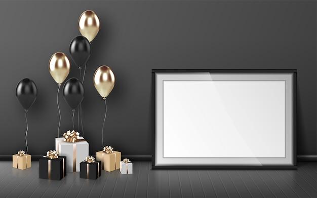空白のフレーム、風船、灰色の壁の背景に金と黒の色のラップされたギフトボックス。誕生日おめでとう、空の境界線と部屋の木の床にプレゼント、現実的な3dベクトル