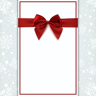Blank greeting card with red bow