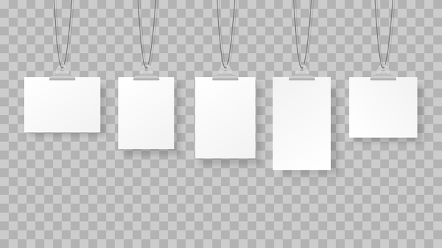 Blank hanging photo frames or poster templates on background.