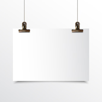 Blank horizontal paper hanging realistic mock up with gold binder clip