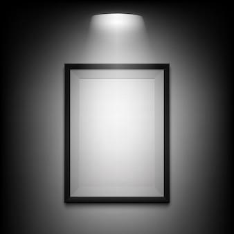 Blank illuminated picture frame on black background.