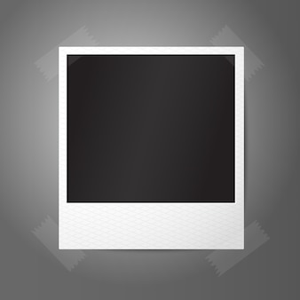 Blank  instant photo frame, sticked to the wall.