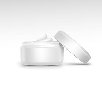 白い背景で隔離のクリーム色の渦と空の瓶