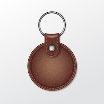 Blank leather round keychain with ring for key isolated on white background