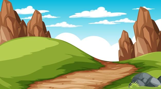 草原を通る小道のある昼間のシーンでの空白の自然公園の風景
