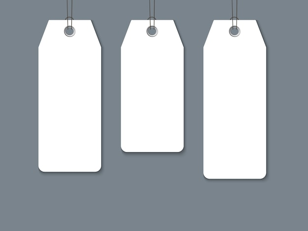 Blank paper label set isolated on dark background.