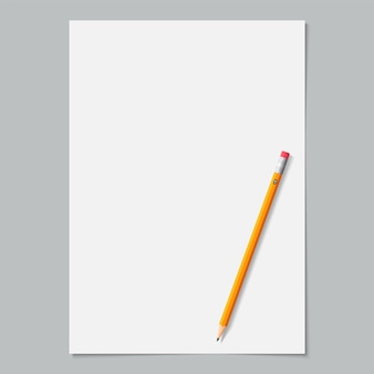 Чистый лист бумаги белого цвета с заточенным желтым карандашом на сером.