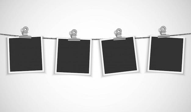 Пустая рамка для фотографий висит на веревке