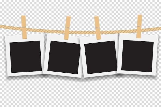 Пустая рамка для фотографий, висящая на линии или веревке.