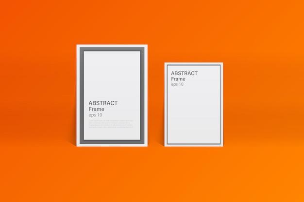 鮮やかなオレンジ色のスタジオルームの空白のフォトフレーム