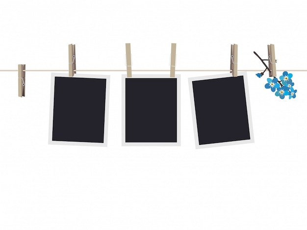 Blank photo frames set hanging on clothespins