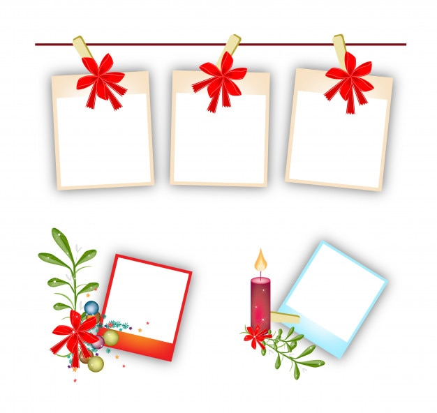 Blank photos with mistletoe bunch, candle and bow