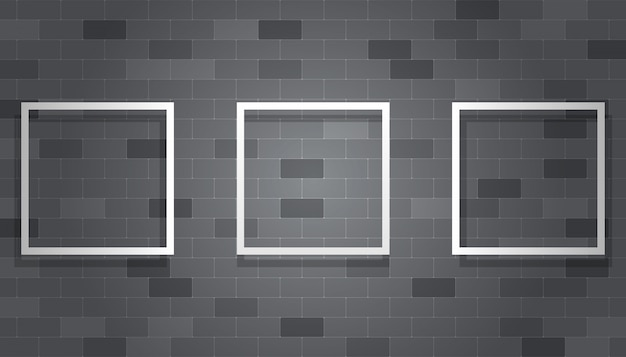 Blank picture frame hanging on the gray brick wall