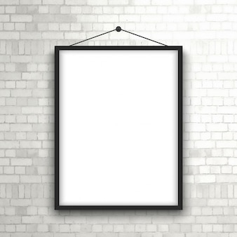 Blank picture frame hanging on a brick wall
