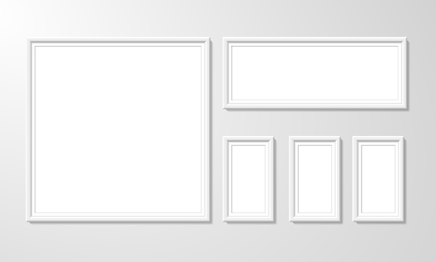 Blank picture frame template set isolated on wall. set of white photo frames.