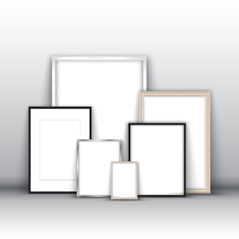 Blank picture frames leaning against a wall