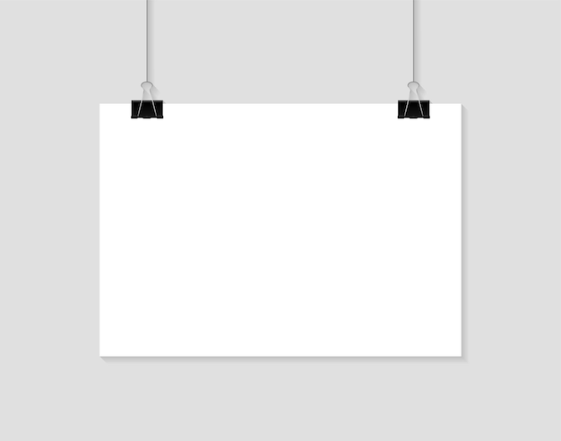 Пустой плакат, висящий на зажимах бумажная страница а4 в портретных форматах
