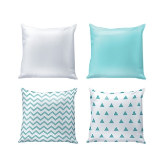 Blank and printed pillows in white and blue colors isolated on background