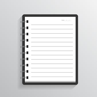 灰色の背景に空白の現実的なスパイラルノートブックノートブック