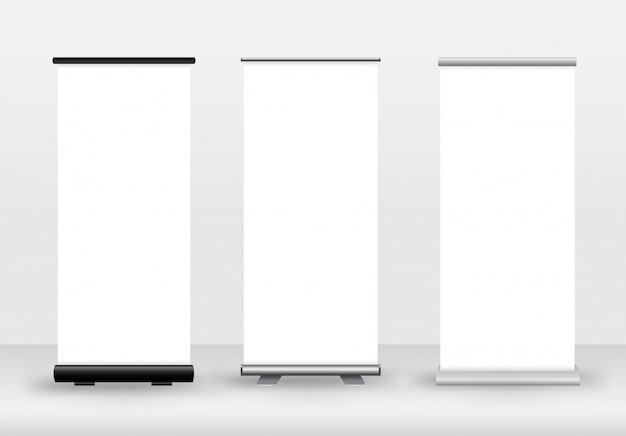 Blank roll-up or x-banner on white. advertising signs, products of the company.