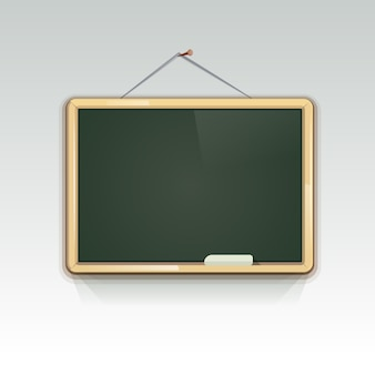 Blank school blackboard hanging on wall