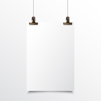 Blank vertical paper hanging realistic mock up with gold binder clip