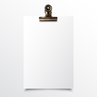 Blank vertical paper realistic mock up with gold binder clip