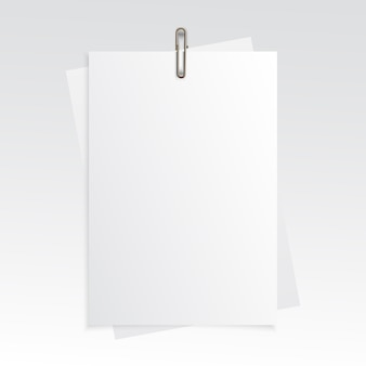 Blank vertical paper realistic mock up with gold paper clip