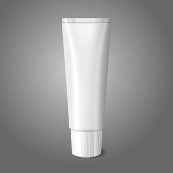 灰色の背景に歯磨き粉、ローション、化粧品、薬のクリームなどの空白の白い現実的なチューブのための場所とブランド。