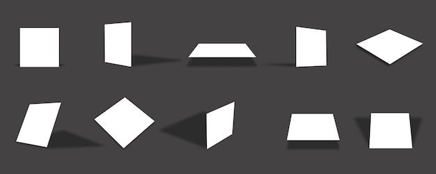 さまざまなビューと角度で空白の白い正方形の紙カードのモックアップコレクション