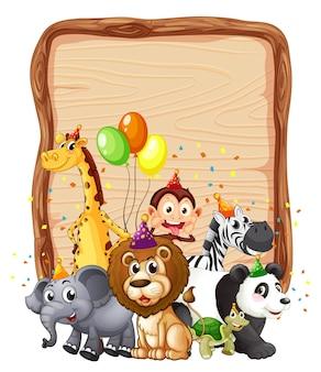 パーティーをテーマにした野生動物と空白の木製ボードフレーム