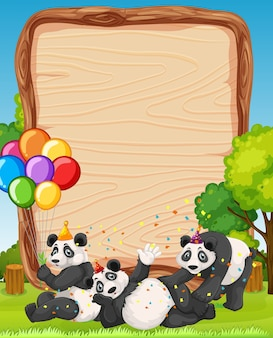 Blank wooden board with pandas in party theme on forest background