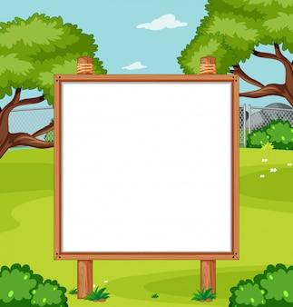 Blank wooden frame in nature park scene