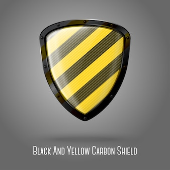 Blank yellow and black caution realistic glossy shield with carbon texture.