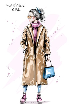 Blond hair girl in coat.