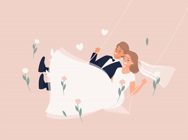 Blonde bride and groom swinging on a swing on the pale pink background