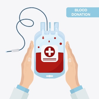 Blood bag with red drop in hand. donation, transfusion concept.