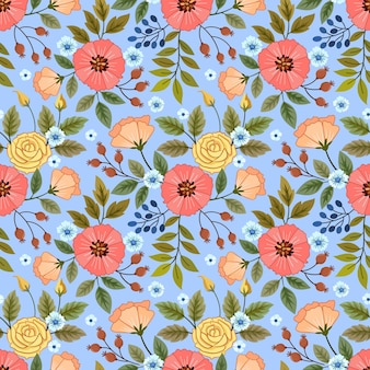 青い色の背景に咲く色とりどりの花。