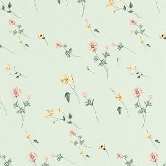 緑の背景に咲く花のシームレスなパターン