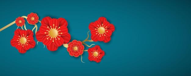青い背景に咲く花。中国の旧正月の装飾。