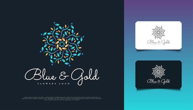 ブルーとゴールドの花飾りのロゴデザイン、スパ、美容、花屋、リゾート、または化粧品のアイデンティティに適しています。エレガントなマンダラのロゴ