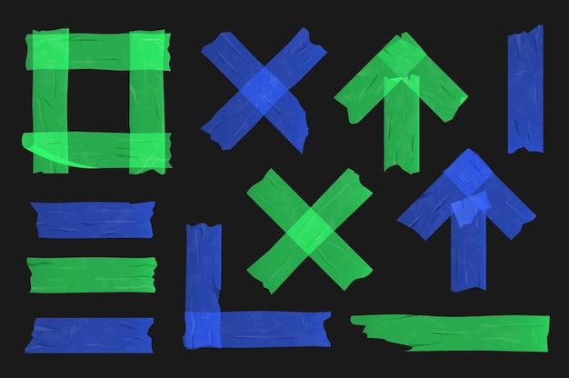 黒の背景に青と緑の粘着テープをセットしました。さまざまなセロテープの作品。