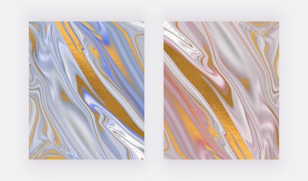 金箔の背景を持つ青とピンクの液体インク。
