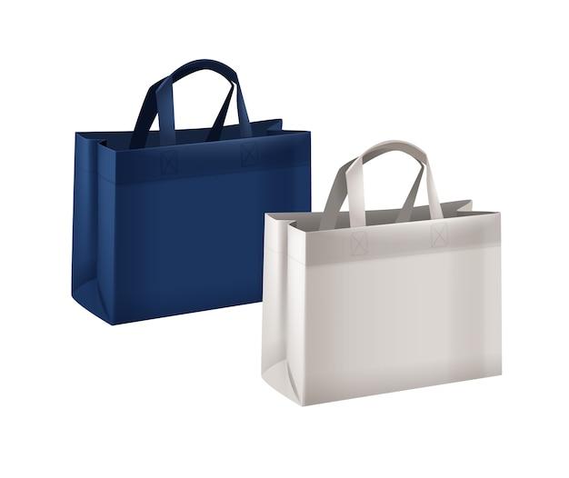 白の背景に分離された青と白の再利用可能なショッピングバッグコレクション