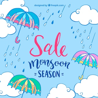 Sfondo blu di ombrello di monsone e gocce di pioggia
