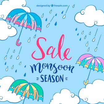 モンスーン傘と雨滴の青い背景