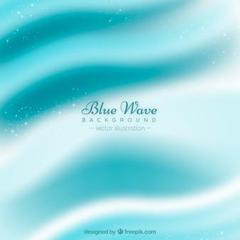 흐린 된 파도와 파란색 배경